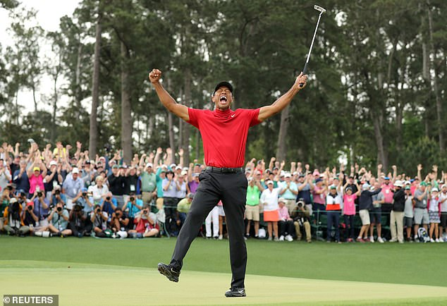 Tiger Woods of the U.S. celebrates on the 18th hole to win the 2019 Masters