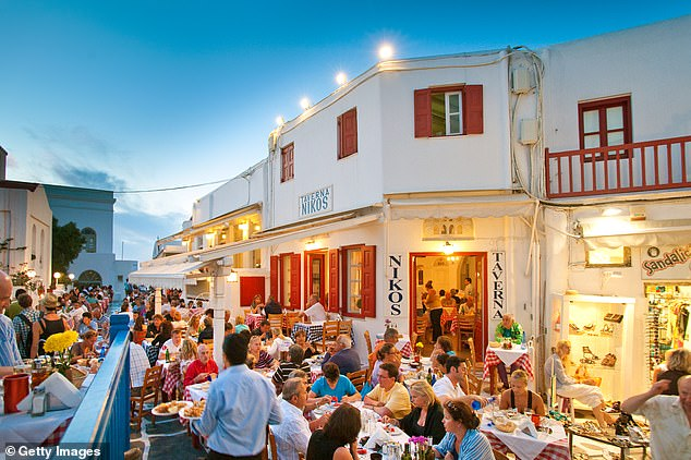 Mr Johnson has asked a new taskforce to look into how holidays can safely be resumed, with ¿vaccine passports¿ seen as one potential long-term measure. Popular holiday destinations such as Greece, Cyprus, Spain and the Canary Islands have already expressed interest in the idea (stock photo of Taverna Nikos, in Mykonos, Greece)