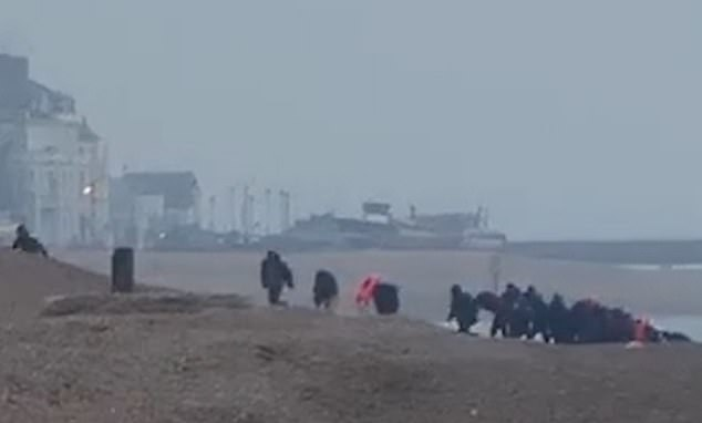 Men believed to be Vietnamese were videoed ditching safety aids and clothing as they ran up the shore towards Walmer in Kent on Tuesday.It came a day after 49 migrants reached Britain as they took advantage of good weather in the Channel