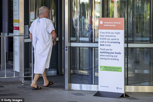 An 94-year-old woman and an 88-year-old man were given more than the prescribed amount of the Pfizer vaccine on Tuesday - the second day of Australia's Covid vaccination rollout. Pictured: Health signage is seen at Gold Coast University Hospital on February 22