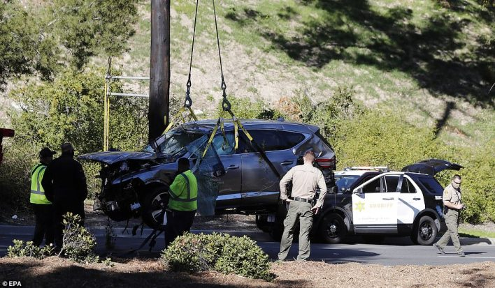 The badly-damaged vehicle, with its airbags inflated, was winched away on Tuesday afternoon