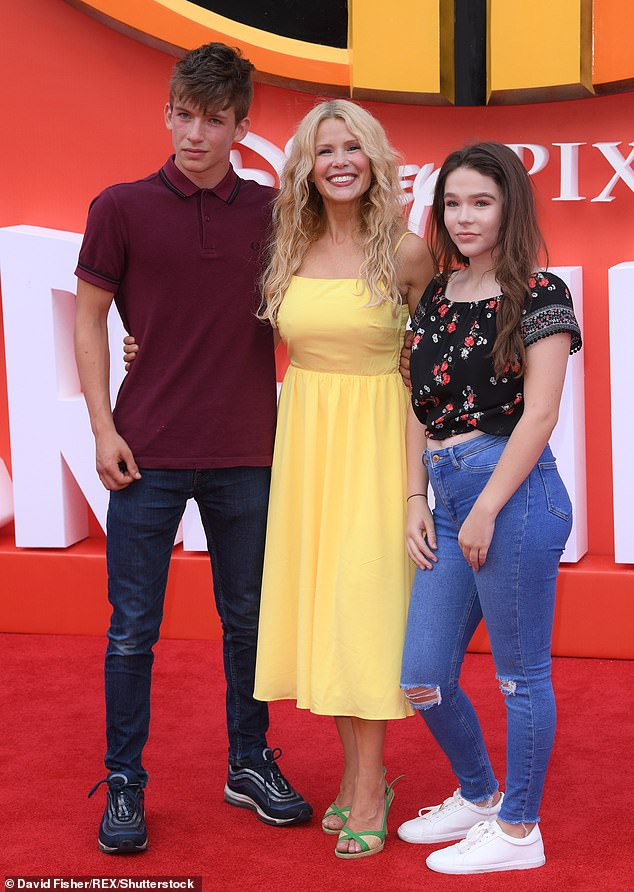 Family first: The British host shares Morgan, 20, Flynn, 19, and Evie, 17, with her ex-partner (pictured with two of her children in 2018)