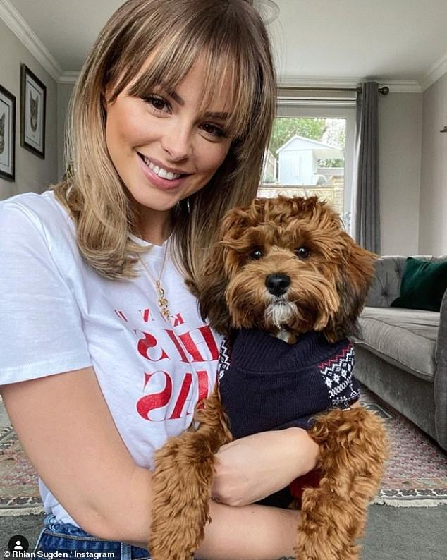 Sweet: Rhian said her puppy has made her feel happy for the first time in months after a gruelling 18 months going through three rounds of IVF