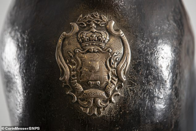 The huge tankard was one of a dozen made from the hide of Cromwell's dead horse and it would have been used to carry water or ale