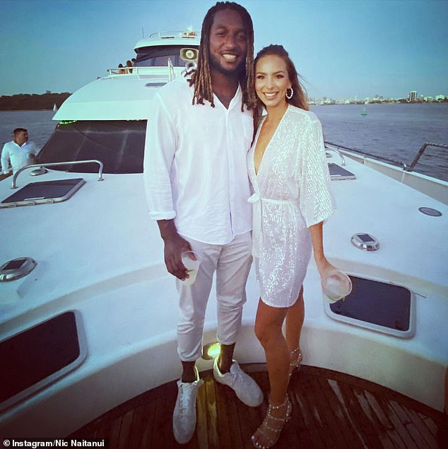 AFL superstar Nic Naitanui (left with his girlfriend Brittany) has lifted the lid on his wild trip to the Middle East