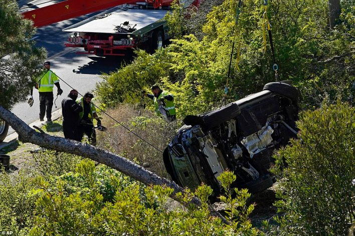 Woods' SUV was removed from the site on Tuesday afternoon, following the devastating crash in California
