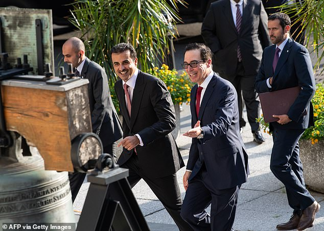 Former US Treasury Secretary Steve Mnuchin, second right, greets the emir of Qatar Sheikh Tamim bin Hamad al-Thani, second left, at the Treasury Department in 2019