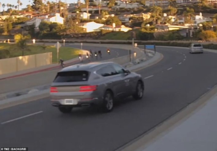 Woods is shown at approximately 7.05am driving in Rancho Palos Verdes in his Genesis GV80, seven minutes before the crash which shattered his legs