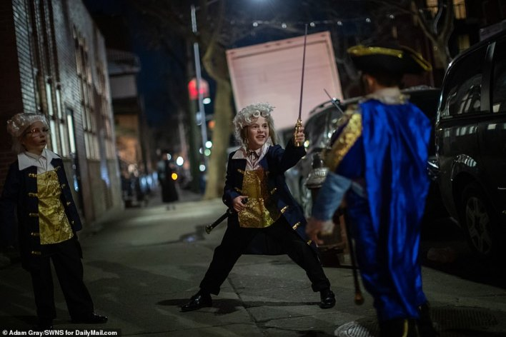Children in Williamsburg, Brooklyn, New York celebrate the festival of Purim which began at sunset on Thursday evenging