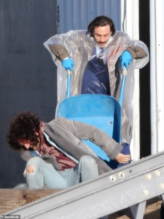 Fight scene: Between scenes, the actor portraying an assassin wore a pair of surgical gloves and a clear plastic poncho over a tweed jacket and striped pants