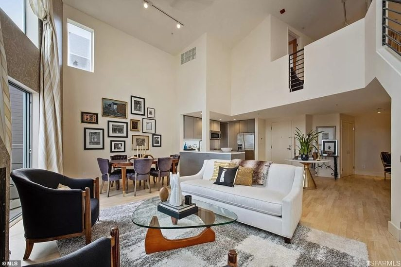 Vice President Kamala Harris' San Francisco condominium was listed online with Anne Herrera of Sotheby's International Realty on February 8. Pictured: A view of the living room, dining room and foyer of the apartment
