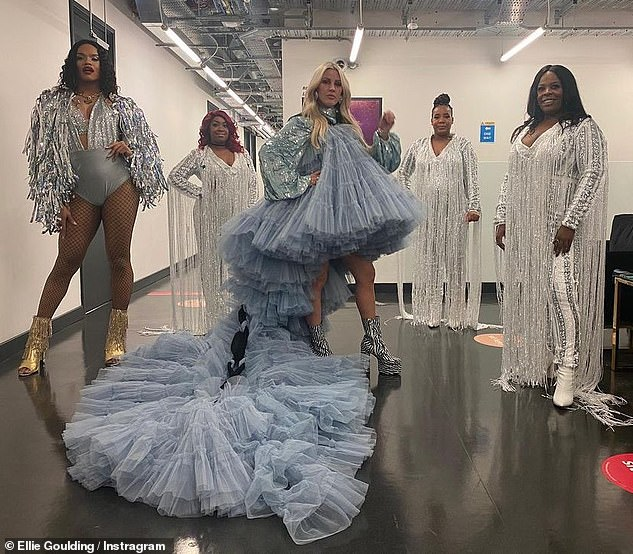 Show stopping:Ellie Goulding looked radiant in a vast blue tulle gown in the behind the scenes snaps from her appearance on Graham Norton in an Instagram post on Friday