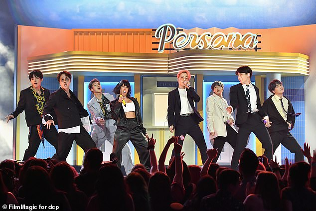 Contributors: Halsey appeared both on stage and in the video for BTS's 2019 song Boy With Luv, which she co-wrote and sang on;  Halsey performing with BTS in Las Vegas in 2019