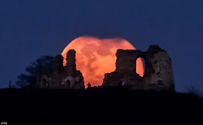 Fascinating pictures show the huge moon sitting above the skyline in St Albans, Kent, Wakefield (pictured) and Tynemouth