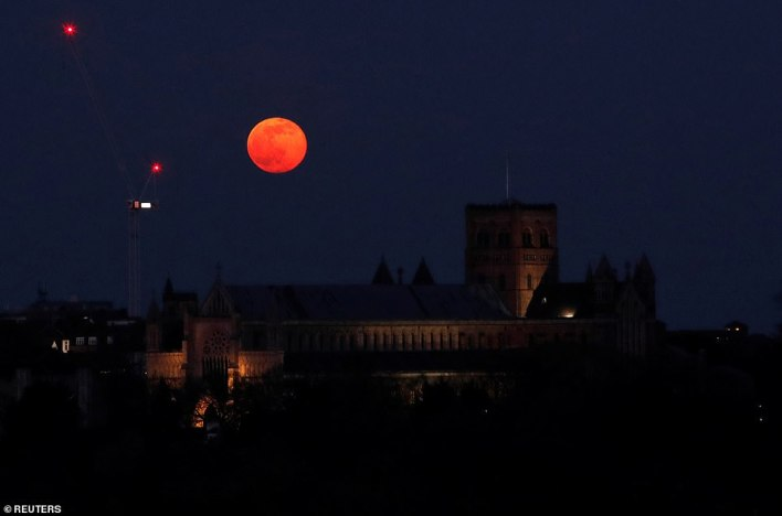 The name 'Snow Moon' derives from Native American tribes and was given because February is the month for snowfall and colder temperatures. Pictured: The Snow Moon over St Albans cathedral