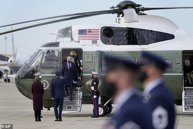 President Joe Biden and first lady Jill Biden exit Marine One as they walk to board Air Force One on Saturday. Biden said he read and released the Saudi report as soon as he could