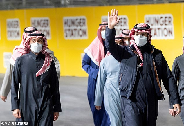 Saudi Crown Prince Mohammed Bin Salman waves on Saturday just days after the report was made public in the U.S. claiming he had authorizedJamal Khashoggi's killing