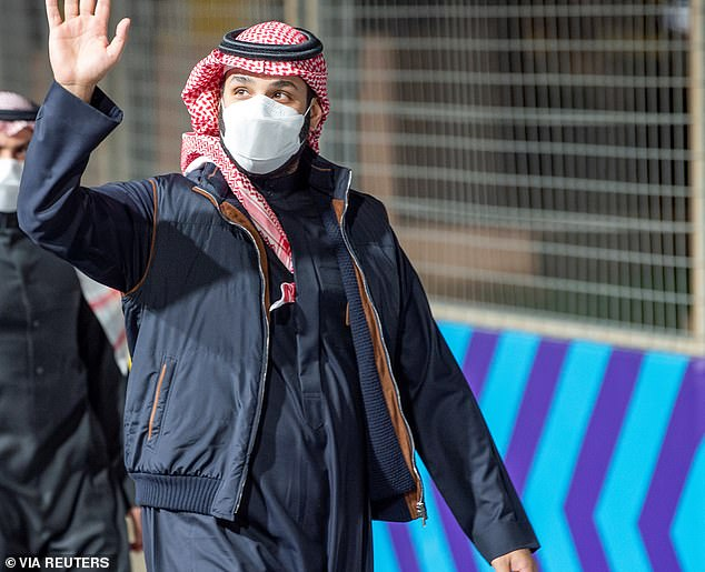 Pictured,Saudi Crown Prince Mohammed Bin Salman waves as he arrivesat Diriyah E-Prix 2021 in Riyadh on Saturday. Biden has faced criticism for not being tougher on MBS