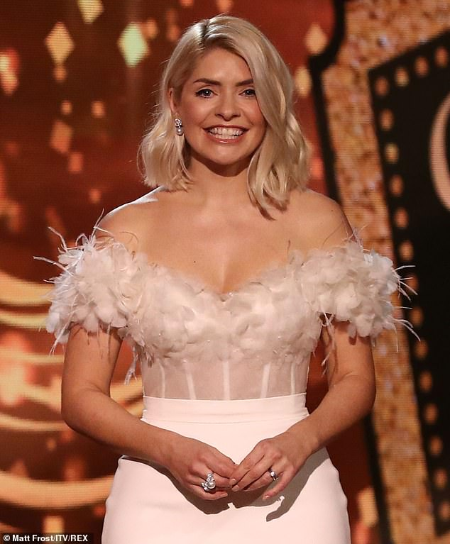 Prepared to fight: Holly Willoughby (pictured) is gearing up for a legal fight with her old agents in a row that could cost £10million, insiders claim