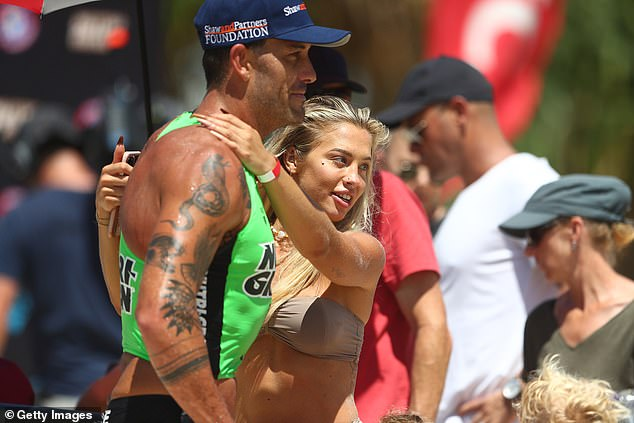 Going strong: Tammy Hembrow, 26, supported her beau Matt Poole, 32 (both pictured) during the Nutri-Grain Ironman Series in Kingscliff, NSW on Sunday.