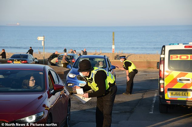 Police officers stop to issue compliance letters to motorists travelling from afar to South Shields seaside, in South Tyneside this afternoon
