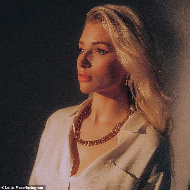 Demure: Pairing her cream outfit with a chunky gold necklace, the 23-year-old model, Kate Moss's younger sister, looked relatively modest as she posed for the picture