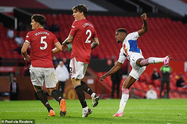 Wilfried Zaha scores Crystal Palace's third goal in their 3-1 victory at Old Trafford in September