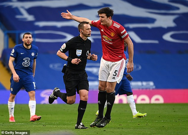 Attwell told Man United captain Harry Maguire (right) he did not award the penalty so he could avoid a backlash, according to Luke Shaw
