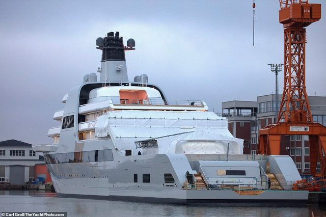 Roman Abramovich's new £430million superyacht hit the water for the first time after being launched at a German shipyard on Monday (pictured)