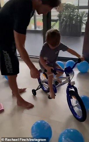 """Impressive: The footage showed him walking down the stairs with his six-year-old sister, Violet, then walking around the living room and screaming, """"So many balloons!"""