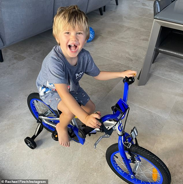 Create memories!  Another photo showed the youngster circling the house on a blue bicycle with training wheels, which was a gift from his parents.