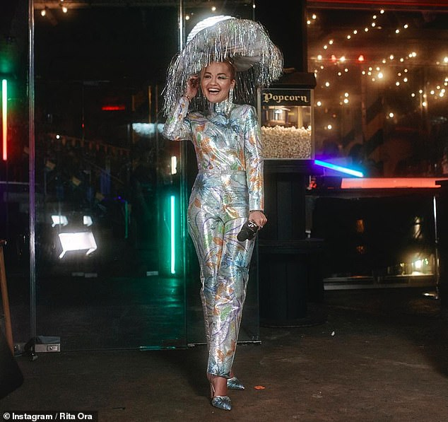 Wow!  Rita Ora, 30, got into the festive spirit on Wednesday by donning a dazzling silver jumpsuit to celebrate Mardi Gras in Sydney