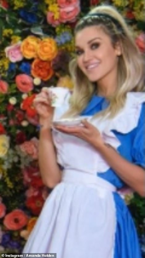 Traditional: Pussycat Doll star posed with her hot drink for playful footage