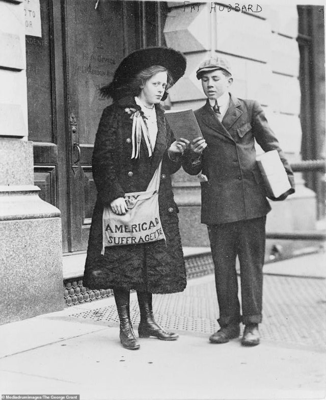 13-year-old suffragette Fay Hubbard (left) is seen in this picture showing a propaganda leaflet to a young boy on February 9, 1910 in new York City. The caption on her bag reads 'American Suffragette'. At the time the picture was taken, Fay would often be seen walking through crowds trying to sell suffragette leaflets. She was the niece of the suffragette's secretary Mrs E. Ida Williams. The suffragette movement in America was a decades-long struggle for women to be given the right to vote in elections. The fight for the right to vote took nearly 100 years