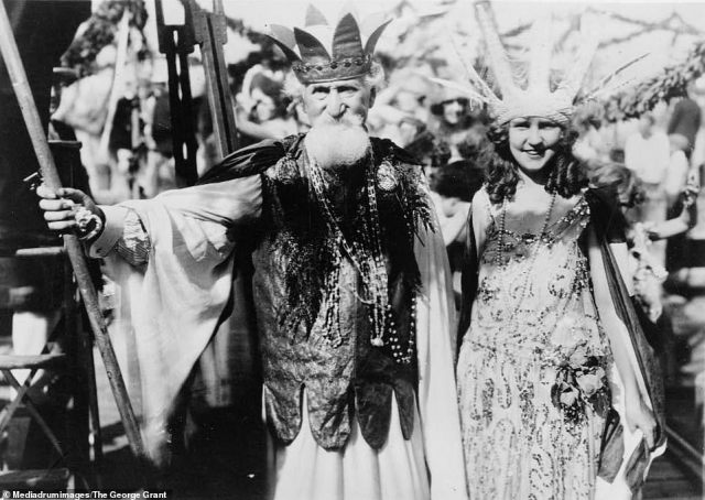 Hudson Maxim, dressed in costume as Neptune, and Miss America Margaret Gorman are seen standing together in this photograph taken at the Atlantic City Carnival on September 7, 1922. Maxim was a US inventor and chemist who was responsible for developing a number of explosives, including smokeless gunpowder. Margaret Gorman was a model and beauty queen who was crowned the first ever winner of Miss America, having previously also been named Miss Columbia in 1921