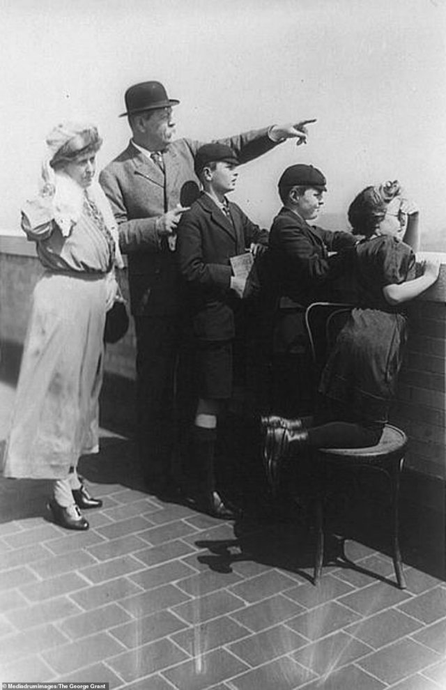 Another image of Sir Arthur Conan Doyle in the collection sees him in New York City with his family in 1922. He is seen alongside his second wife Jean Elizabeth Leckie pointing forwards as his children stare out into the distance over a brick wall. Throughout his life, Conan Doyle was married twice and fathered five children across the two marriages. Sir Doyle had originally fallen in love with Leckie in 1897 but the pair decided to maintain a platonic relationship until his first wife passed away out of respect for her