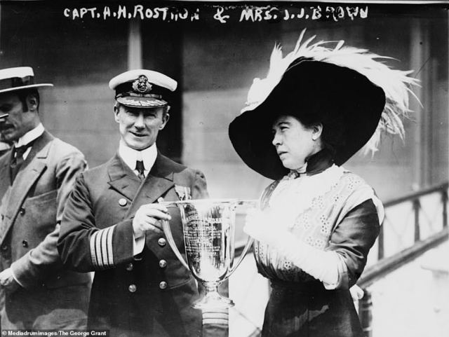 Another image of Titanic survivor Mrs Brown shows her presenting a trophy to Captain Arthur Henry Roston for his service in the rescue of the Titanic, on May 1912. Roston had been captain of the ocean liner RMS Carpathia when it rescued hundreds of survivors from the RMS Titanic after the latter ship sank in 1912 in the middle of the North Atlantic Ocean