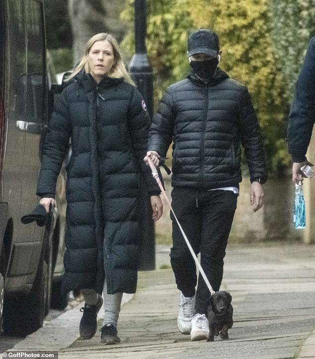 Don't mind: Declan Donnelly enjoyed relative peace away from the spotlight on Thursday as he walked his pet dog with wife Ali Astall in London