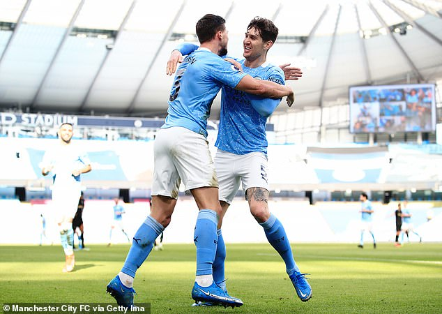 Ruben Dias and John Stones have laid the foundations for champions-elect Manchester City