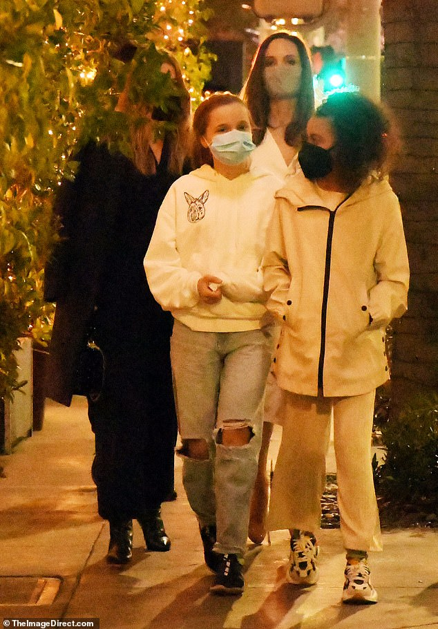 Caution: Angelina and Ellen, 51, wore face masks amid the coronavirus pandemic as they stepped out after their meal
