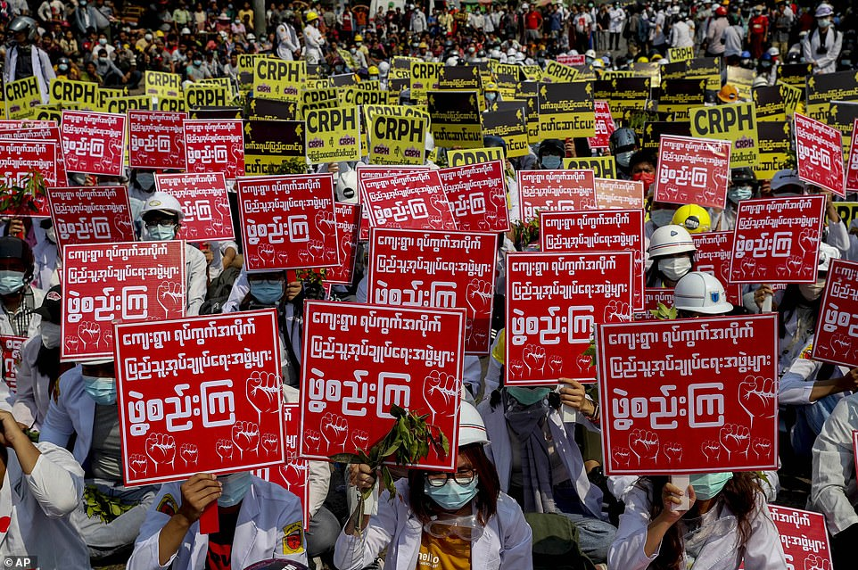 Medical students display placards during an anti-coup demonstration in Mandalay on Thursday