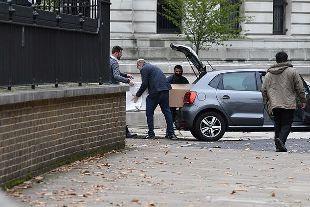 The hampers are so heavy that Downing Street staff use a large trolley to ferry them to Mr Johnson and Miss Symonds¿ Number 11 flat