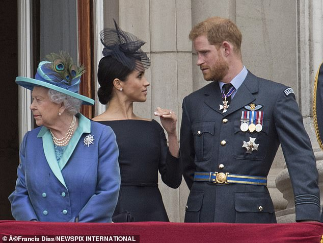 The Queen (pictured with the couple in 2018) launched an unprecedented inquiry last night into allegations that Meghan and Harry bullied their staff