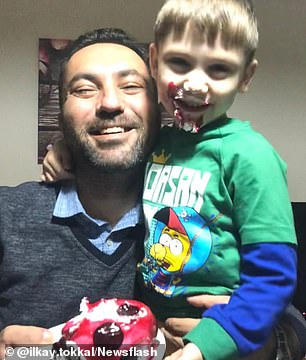 Ilkay Tokkal, 42, poses with his four-year-old son
