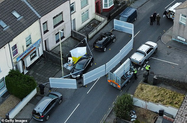 An aerial view showing a police forensics team working at the scene in Treorchy, Wales