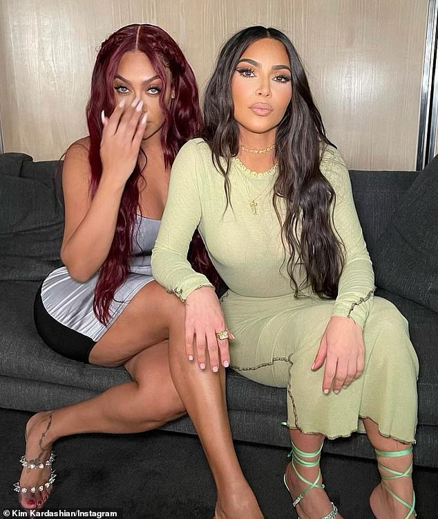 Indifferent: Kim showed off her free hand for her wedding ring as she took to Instagram on Thursday to share a series of snaps from a girls' night out with BFF Lala Anthony