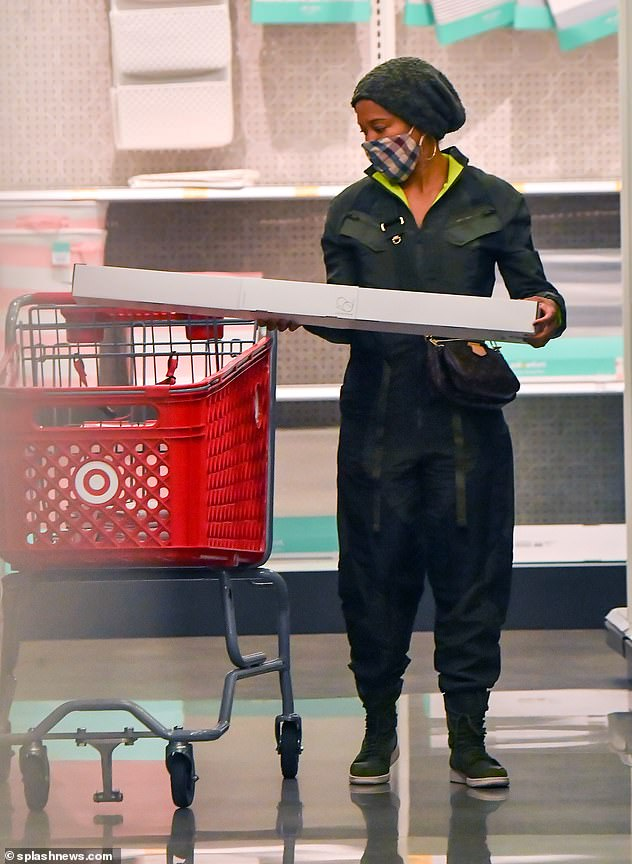 For the house: While in the store, King was seen pushing her shopping cart while searching for items for her house, including a large curtain rod.