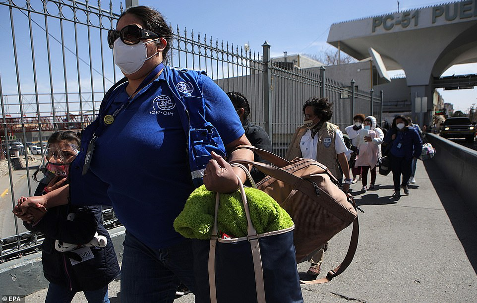 MPP, branded the 'Remain in Mexico' policy by Trump, was an 'incredible' policy, the former President claimed as he blasted Trump for ending it. Pictured, members of the International Organization for Migration (IOM) escort migrants to the United States as part of the Migrant Protection Protocol (MPP) program at the border with Mexico on Thursday