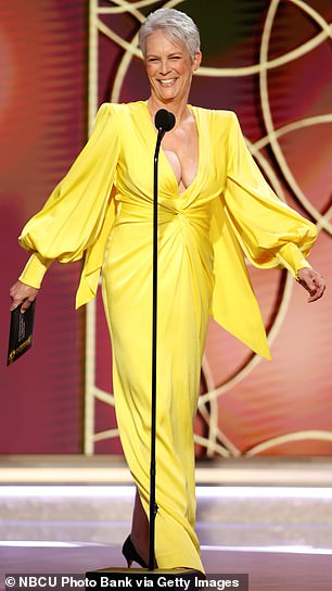 Ravishing look: She looked ravishing in the floor-length number, which featured padded shoulders and long billowy sleeves