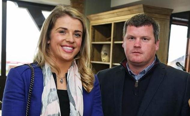 Mr Elliott is pictured above with his girlfriend, TV presenter Kate Harrington